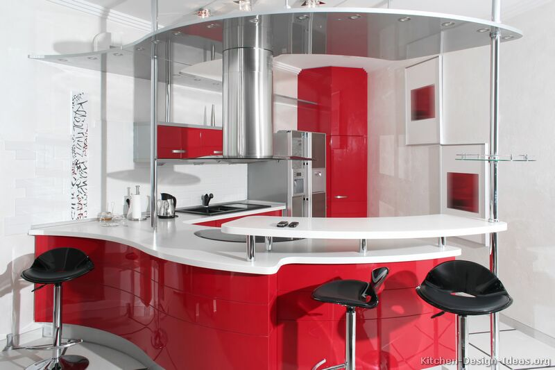 A Modern Take On A Retro Kitchen With Curved Red Cabinets, Chrome Accents,  Retro